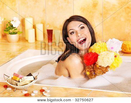 Young woman take bubble  bath. Group bath sponge.