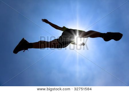 The Silhouette of runner acrossing sky