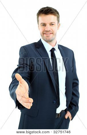 Business man saying welcome and giving hand