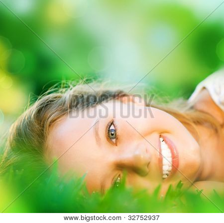 Spring Girl in Green Grass