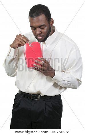 Man Eating Asian Food