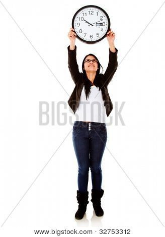 Woman holding a clock - isolated over a white background