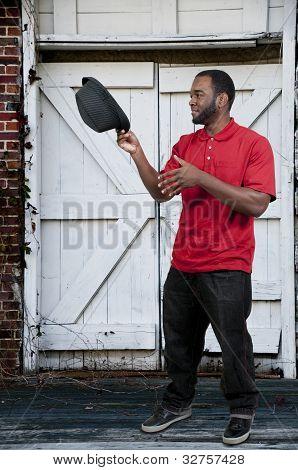 Hombre negro en Fedora