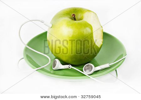 Green Apple With Headphones On Green Plate
