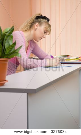 Woman Receptionist Write A Note