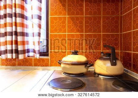 poster of Original Vintage Kitchen Of Middle Class With Orange Tiles And Old Stove With Kitchen Tools Pans Ret