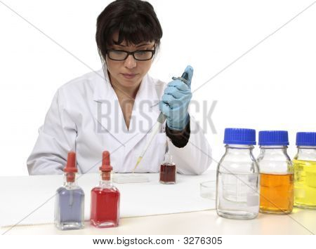 Scientist Using Pipette And Spotting Plate