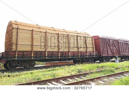 Freight Train With Wood Cargo Transportation On Railway