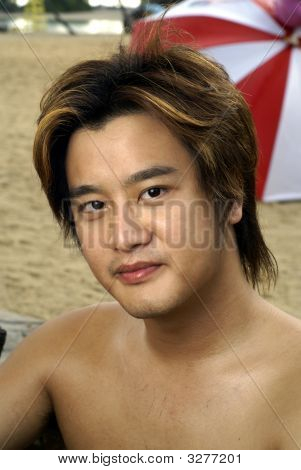 Smiling Asian Man At Beach