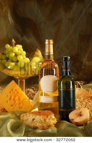 Still life with cheese, bread, grapes and two bott