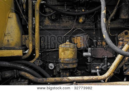 The engine of the tractor
