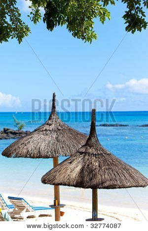 Sun-protection umbrellas beach sea. Mauritius
