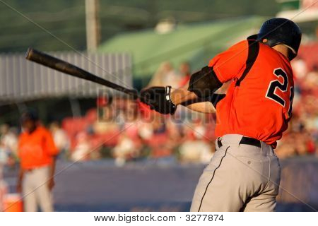 Baseball Player Swinging At A Pitch