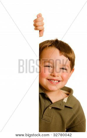Portrait of happy young boy child peeking around corner isolated on white