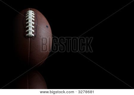 Football On Black Background