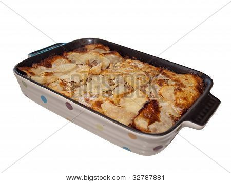Lasagna in colorful ceramic casserole