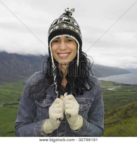 Hispanic woman wearing hat and gloves