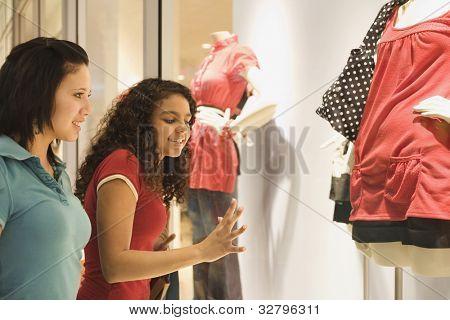 Multi-ethnic teenage girls window shopping