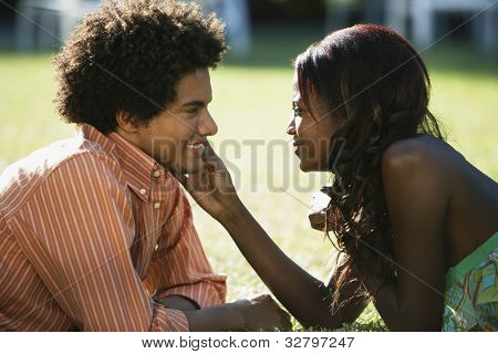 South American couple smiling at each other