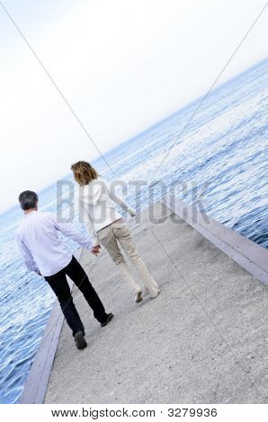 Mature Romantic Couple On A Pier