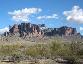foto of superstition mountains  - superstition mountains laced with snow on a peaceful day - JPG