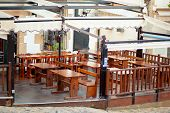 Veranda Cafe With Wooden Furniture Without Visitors poster