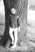 Girl Little Cute Child Enjoy Peace And Tranquility At Tree Trunk. Place Of Power. Peaceful Place. Fi poster
