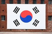 Giant South Korean Flag On The Red Bricks Wall Of Seodaemun Prison Hall A Former Japanese Prison In  poster