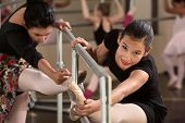 pic of hamstring  - Pretty Hispanic girls warming up in a ballet class - JPG