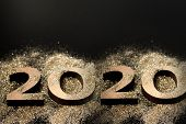 Happy New Year 2020. Creative Collage Of Numbers Two And Zero Made Up The Year 2020. Beautiful Spark poster
