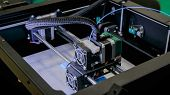 Print Head Of 3d Printer Machine Printing Flat Plastic Model At Modern Scifi Technology Exhibition.  poster