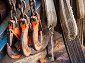 Sturdy Construction Hooks On The Chain. The Hooks Latch Hooks For Heavy Loads. Orange Hooks poster