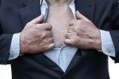 Senior Man Tearing A Shirt And A Suit On His Chest Showing Hairy Bare Torso poster