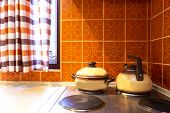 Original Vintage Kitchen Of Middle Class With Orange Tiles And Old Stove With Kitchen Tools Pans Ret poster