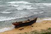 Korean Fishing Boat Wreck On Sandy Sea Beach After The Storm. Broken Boat Of Poor North Korean Fishe poster