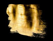 Creative brushstrokes of gold paint isolated on a black background. Gold paint texture.Acrylic gold  poster