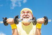 Senior Man Workout In Rehabilitation Center. Elderly Man Practicing Sports On Blue Sky Background. S poster