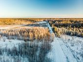 Beautiful Aerial View Of Snow Covered Fields With A Road Among Trees. Rime Ice And Hoar Frost Coveri poster