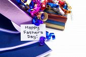 foto of stereotype  - Happy Fathers Day tag with gift boxes and tie close up - JPG