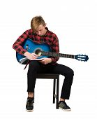 Full Length Portrait Of Talented Boy Music Composer With His Trendy Acoustic Guitar Seated On Chair  poster
