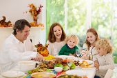 Family With Kids At Thanksgiving Dinner. Turkey. poster