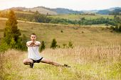 Runner Man Stretching Legs Before Cross Country Trail Run. Fit Male Runner Exercise Training Outdoor poster