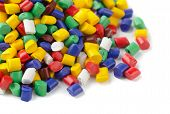 picture of thermoplastics  - colourful plastic polymer granules on white background - JPG