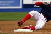 pic of umpire  - a baseball player sliding into third base - JPG