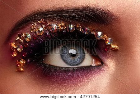 Closeup image of eye with fantasy makeup