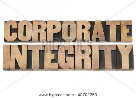 corporate integrity  - business ethics concept - isolated text in vintage letterpress wood type printing blocks