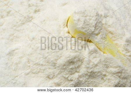 Powder Milk And A Yellow Spoon