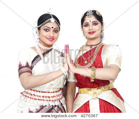 Female Odissi Dancer Of Indian Origin Enjoying Music