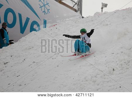 BUKOVEL, UKRAINE - FEBRUARY 23: Zhanbota Aldabergenova, Kazakhstan performs landing after aerial skiing during Freestyle Ski World Cup in Bukovel, Ukraine on February 23, 2013.