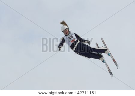 BUKOVEL, UKRAINE - FEBRUARY 23: Madison Olsen, USA performs aerial skiing during Freestyle Ski World Cup in Bukovel, Ukraine on February 23, 2013.